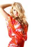 Reizvolles Mädchen im orange Kleid Lizenzfreies Stockbild