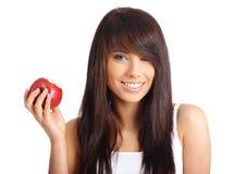 Reizvolles Mädchen mit Apfel Stockfotografie