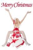 Reizvolles Mädchen mit dem blonden lockigen Haar gekleidet als Sankt Lizenzfreies Stockfoto
