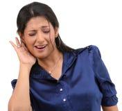 Reizvolles Mädchen mit der Hörfähigkeitslage Stockfoto