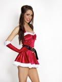 Reizvolles rotes Weihnachtsfeiertagskostüm lizenzfreie stockfotografie