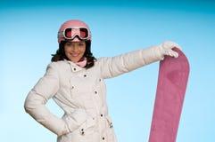 Reizvolles Snowboardmädchen im Weiß und im Rosa Lizenzfreies Stockbild