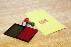 Reject. Office series with stamp and pad on desk with manila envelope. Room for text or logo royalty free stock images