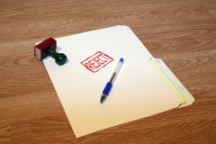 Reject. Office series with stamp and pad on desk with folder and pen. Room for text or logo stock photos
