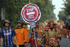 Reject money politics. Activists campaign to refused money politics in Solo, Central Java, Indonesia Royalty Free Stock Photography
