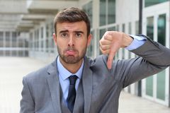 Rejected businessman whining in the office.  Stock Photo