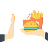 Rejecting the offered junk food. Royalty Free Stock Photography