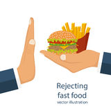 Rejecting offered junk food. Rejecting the offered junk food. Gesture hand NO rejecting fast food. Offer fries and a hamburger in hand. Stop fat, calorie Royalty Free Stock Images