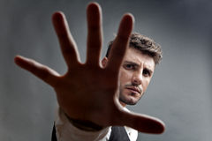 Rejection. Concept with portrait of man with outstretched hand and spread fingers Stock Photo