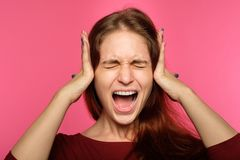 Rejection refusal hear woman cover ears screaming. Don`t want to hear it. rejection refusal and denial. young woman covering ears with hands. portrait of a stock photography