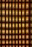 Rejilla del calabozo con el contraluz amarillo Imagen de archivo libre de regalías