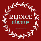 Rejoice always verse in white flora circle on red background. Christianity art with 1 Thessalonians 5:16 Stock Photo