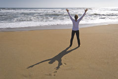 Rejoicing at beach stock photography