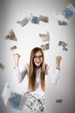 rejoicing Femme dans le blanc et l'euro Photographie stock libre de droits