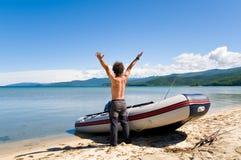Rejoicing fisherman Royalty Free Stock Image
