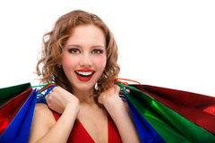Rejoicing girl in red dress Royalty Free Stock Photos