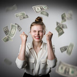 Rejoicing. Girl in white and dollars. Stock Photos