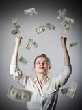 Rejoicing. Girl in white and dollars. Stock Photo