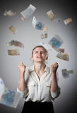 Rejoicing. Girl in white and Euro. Royalty Free Stock Photos