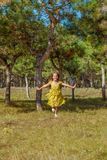 Rejoicing happy little girl. In flying motion smiling full of joy and vitality in summer or spring forest Stock Images