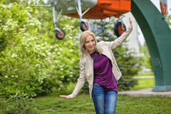 Rejoicing happy woman in flying motion. Smiling full of joy and vitality in summer or spring forest Royalty Free Stock Photography