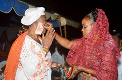 Rejoicing madness in africa. Abidjan, Ivory Coast - February 26, 2015: TRADITIONAL rejoicing during the wedding ceremony in Africa. The bride gives banknotes to Stock Image