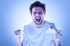 Rejoicing Man with Gamepad Royalty Free Stock Image