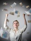 rejoicing Menina no branco e no Euro Fotografia de Stock Royalty Free
