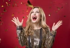 Rejoicing pretty woman enjoying glitter decorations royalty free stock photography