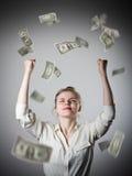 rejoicing Ragazza nel bianco e nei dollari Fotografia Stock