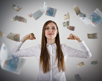Rejoicing. Strong business woman concept. Girl in white and Euro Royalty Free Stock Photos