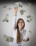Rejoicing. Woman in white and dollars. Royalty Free Stock Images
