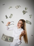 Rejoicing. Woman in white and Dollars. Stock Photos