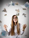 Rejoicing. Woman in white and Euro. Royalty Free Stock Image