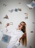Rejoicing. Woman in white and Euro. Royalty Free Stock Images