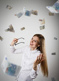 Rejoicing. Woman in white and Euro. Stock Photography