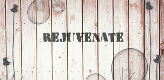 Rejuvenate  against wooden background with plugs Stock Image