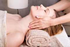 Rejuvenating Face  massage. Caucasian women having classic Face massage Stock Photos