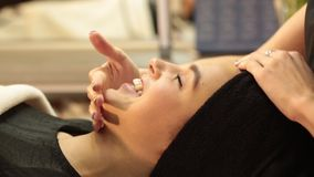 Rejuvenating facial treatment. Model getting lifting therapy massage in a beauty SPA salon. Exfoliation, Rejuvenation