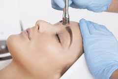 A rejuvenating treatment. The profile of a woman who lies in the beautician during the procedure Royalty Free Stock Images