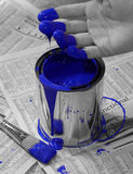 Rejuvenation - painted. Fingers and brush dipped in bright blue paint can. Saturation is washed out except for blue Royalty Free Stock Photos