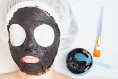 Rejuvenation and skincare in spa salon with mud face mask Stock Image