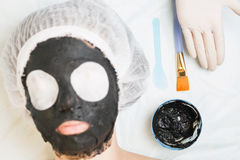 Rejuvenation and skincare in spa salon with mud face mask Royalty Free Stock Image