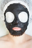 Rejuvenation and skincare in spa salon with mud face mask Stock Photos