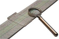 Rekenliniaal en meer magnifier stock fotografie
