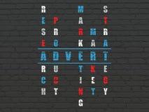 Reklamowy pojęcie: Ogłoszenie w Crossword łamigłówce obraz royalty free