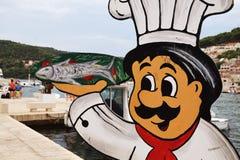 Reklamowy sztandar PuÄ  iÅ ¡ Ä ‡ a - Cook z rybą - fotografia stock