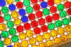 Rektangulära rader och kolonner av färgrikt plast- ben Royaltyfria Bilder