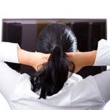 Relájese en la TV Imagen de archivo libre de regalías