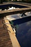 Relájese por la piscina Imágenes de archivo libres de regalías